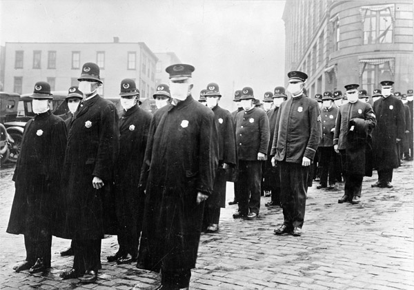 Policemen in Seattle wearing masks made by the Red Cross, during the influenza epidemic. December 1918.