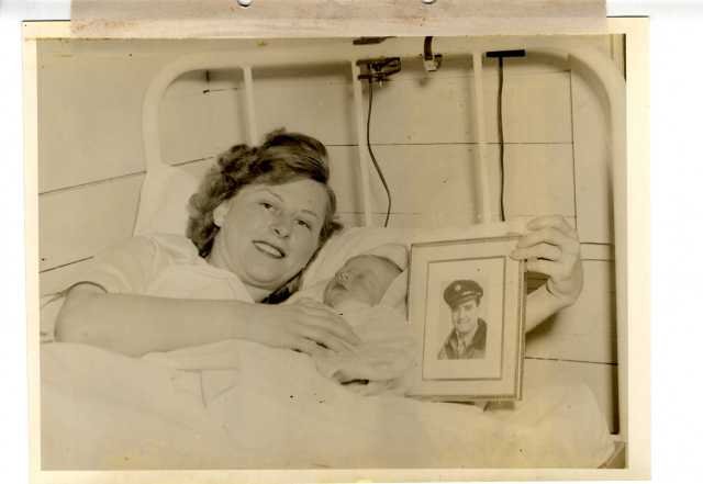 This is a wartime picture too, but it makes me smile--even during wartime, people fell in love, got married, and had babies! Edward Spillane, Jr., was the first baby born at Camp Kilmer, NJ, on March 2, 1945. His mother Dorothy Inman Spillane was a former WAC (Women's Army Corps). The baby's father was S.Sgt. Edward Francis Spillane, but he was in France with the U.S. Army Air Forces at the time of his son's birth, so this photograph completed the family portrait. (Source: Record Group 336, Records of the Office of the Chief of Transportation, National Archives at New York)