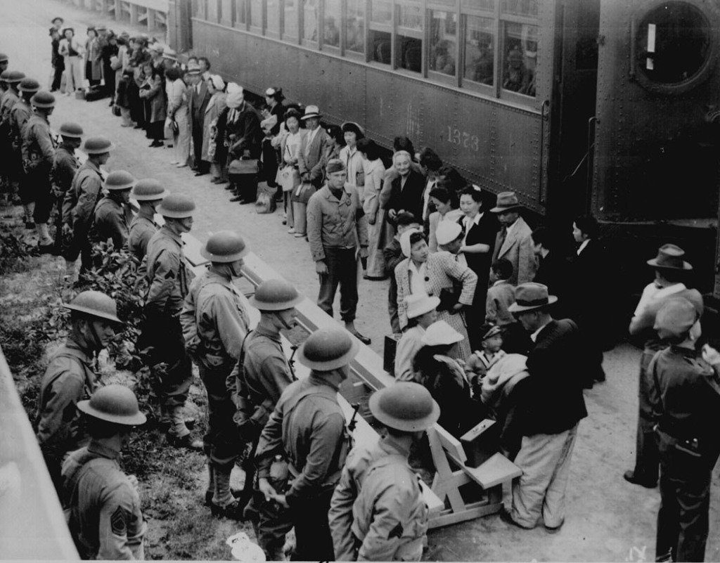 Persons of Japanese ancestry arrive at the Santa Anita Assembly Center from San Pedro. Evacuees lived at this center at the former Santa Anita race track before being moved inland to relocation centers. Clem Albers, Arcadia, CA, April 5, 1942. (Photo No. 210-G-3B-414)