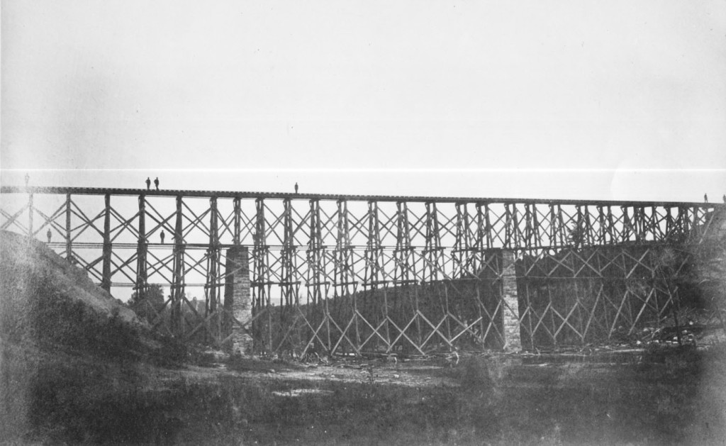 "The Richmond, Fredericksburg, and Potomac Railroad's Potomac Creek Bridge after reconstruction. In May 1862, using unskilled infantry, Haupt rebuilt this bridge in only nine rainy days with considerably more than ""cornstalks and beanpoles."" (64-CV-268)"