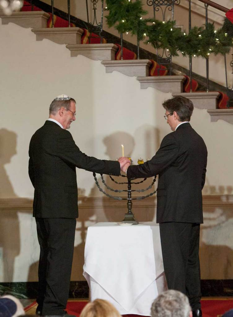 Yariv Ben-Eliezer, grandson of David Ben-Gurion, and Clifton Truman Daniel, grandson of Harry S. Truman, light the menorah for the annual White House Hanukkah Reception.  12/15/2008.  The menorah was a gift from Israel's first Prime Minister David Ben-Gurion to Harry S. Truman.