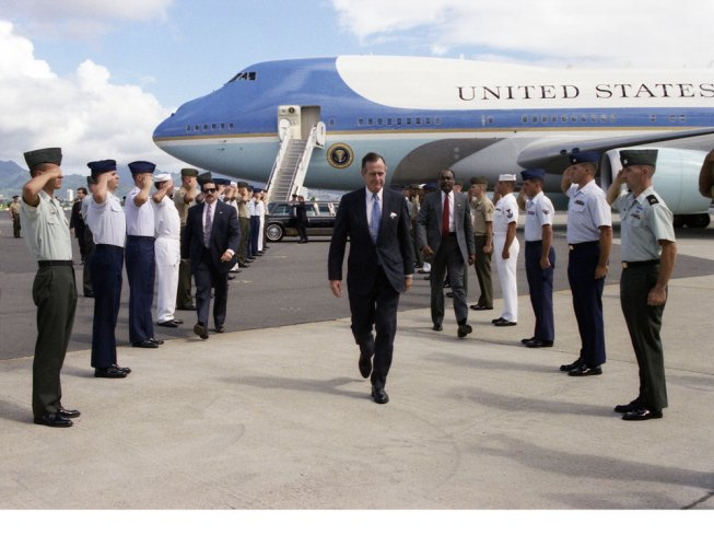 President George Bush is welcomed by Military Personnel to Hickam Air Force Base, Honolulu, Hawaii. 10/28/1990