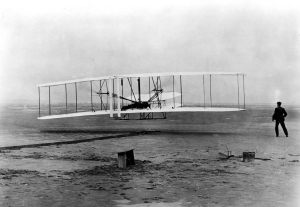 """Original Wright Brothers 1903 Aeroplane ('Kitty Hawk') in first flight, December 17, 1903. (National Archives Identifier 7580929)"