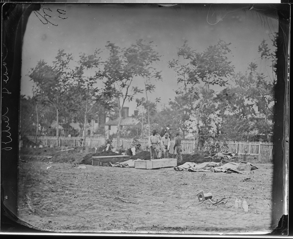 Burying Confederate dead, Fredericksburg, VA, 1863. (National Archives Identifier 524749)