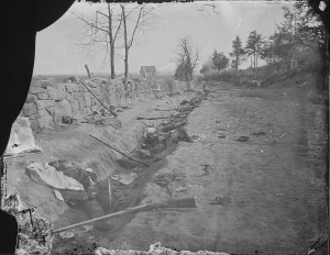 Confederate dead behind stone wall. The 6th. Maine Inf. penetrated the Confederate lines at this point. Fredericksburg, VA, 1863. (National Archives Identifier 524930)