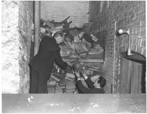 Works Progress Administration surveyors inspecting records storage conditions in Massachusetts, 1936. (Records of the Work Projects Administration)