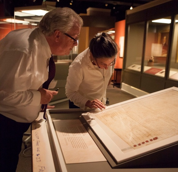 James Zeender and Terry Boone of the NAtional Archives examine the Treaty between U.S. and Sauk and Fox Indians, signed in 1804 at St. Louis. (Photograph courtesy of the Missouri History Museum)