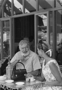 Ernest Hemingway and actress Lauren Bacall having espresso in Pamplona, Spain, 1959. (National Archives Identifier 192696)