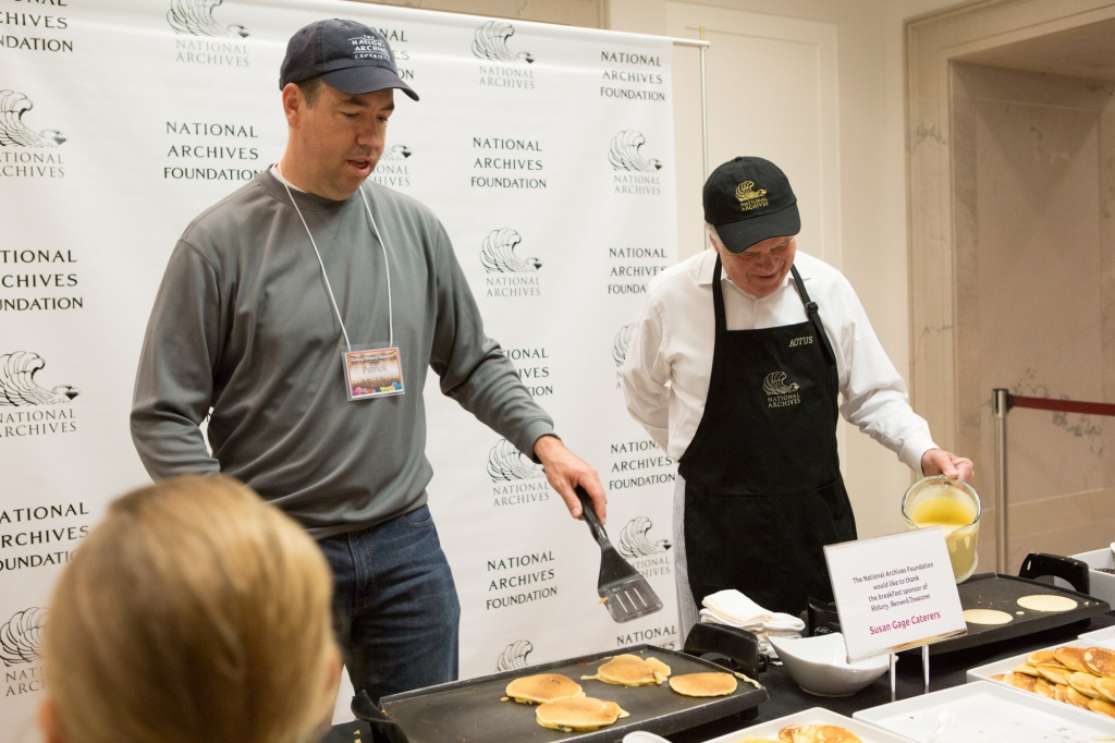 Southpaws at work! Patrick Madden, director of the Foundation for the National Archives, and David Ferriero, the Archivist of the United States, flip pancakes.