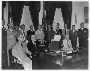 President Harry Truman reads the Japanese message agreeing to unconditional surrender on August 14, 1945. (Harry Truman Library)