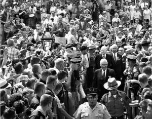 Former Presidents Harry S. Truman and Herbert Hoover move through the crowds of people attending the dedication of the new Hoover Presidential Library and Museum in West Branch, IA, August 10, 1962. Harry S. Truman Library & Museum, National Archives.)
