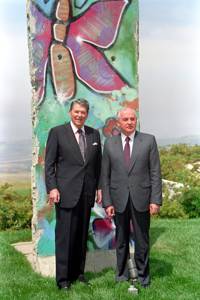 President Reagan Poses with Mikhail Gorbachev by the Piece of the Berlin Wall at Library, May 5, 1992. (Ronald Reagan Presidential Library and Museum, National Archives)