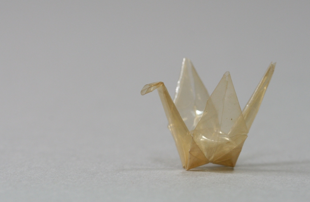 """Sadako Crane"" donated to the Harry S. Truman Presidential Library by her brother, Masahiro Sasaki. The crane is about one inch tall and made from a cellophane wrapper."