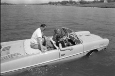 President Lyndon B. Johnson in the Amphicar with Eunice Kennedy Shriver and Paul Glynn. Haywood Ranch, near Kingsland, Texas. 4/10/65.
